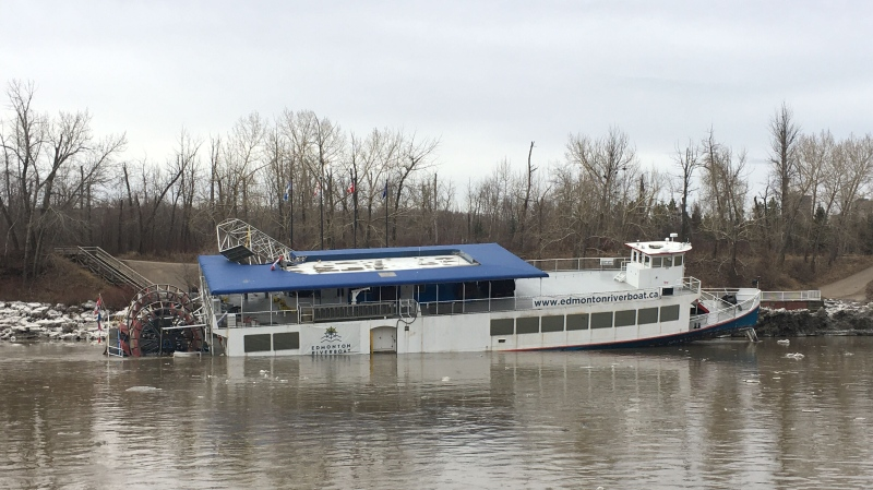 Ice jammed up between the boat and river shore, causing Edmonton Riverboat to twist and appear as if it was taking on water on April 22, 2020.