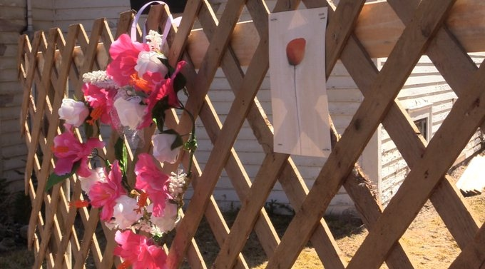Cees van den Hoek has put up lattice fencing in front of the former church and encourages anyone to drop off or send cards, flowers, or other items in tribute to the victims of the mass shooting.