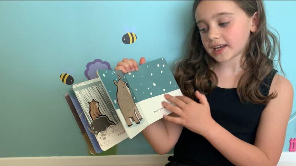 Lyla reading a story called When