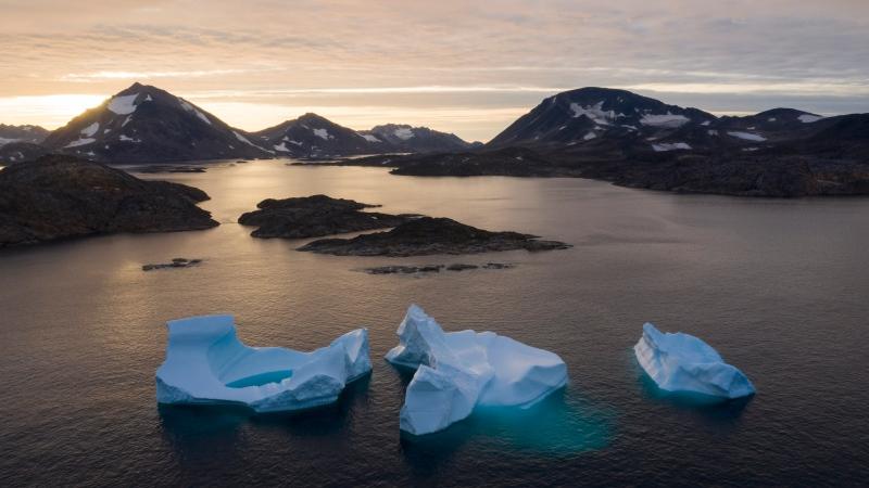 In this Aug. 16, 2019, photo, large Icebergs float away as the sun rises near Kulusuk, Greenland. (AP Photo/Felipe Dana, File)