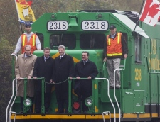 James D. Irving, Saint John MP Rodney Weston, Prime Minister Stephen Harper and Finance Minister Jim Flaherty, left to right, ride on an Irving-owned NB Southern Railway locomotive before Harper released the government's latest economic update in Saint John, N.B. on Monday, Sept. 28, 2009. (Andrew Vaughan / THE CANADIAN PRESS)