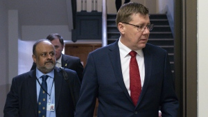 Premier of Saskatchewan Scott Moe and Saqib Shahab, chief medical health officer, arrive to a COVID-19 news update at the Legislative Building in Regina on Wednesday March 18, 2020. THE CANADIAN PRESS/Michael Bell