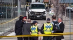 Police are seen near a damaged van in Toronto after a van mounted a sidewalk crashing into a number of pedestrians on Monday, April 23, 2018. (Aaron Vincent Elkaim/The Canadian Press)