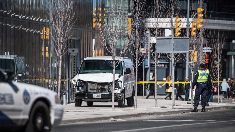 Police are seen near a damaged van in Toronto after a van mounted a sidewalk crashing into a number of pedestrians on Monday, April 23, 2018. Toronto will commemorate the second anniversary of a deadly van attack virtually due to the COVID-19 pandemic. THE CANADIAN PRESS/Aaron Vincent Elkaim