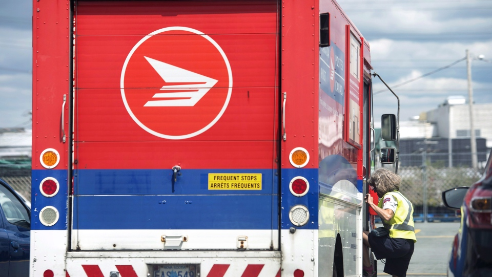 Canada Post says it is experiencing Christmas-level parcel volumes as Canadians do more of their shopping online amid COVID-19. THE CANADIAN PRESS/Darren Calabrese