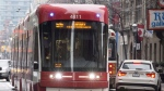A TTC streetcar is seen in Toronto, November 13, 2017. THE CANADIAN PRESS/Doug Ives