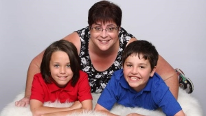 A family photo of Monique Berniquer (top) with her two 11-year-old adopted twin sons, Jayden (left), and Richard (right). (Image courtesy: Monique Berniquer)
