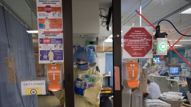 Registered nurse Cayli Hunt puts on her personal protective equipment prior to entering a COVID positive room in the COVID-19 intensive care unit, Tuesday, April 21, 2020. THE CANADIAN PRESS/Jonathan Hayward