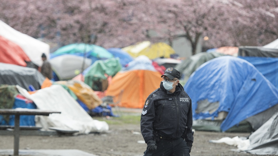 A Vancouver Police officer is seen at Oppenheimer Park in Vancouver's downtown eastside Thursday, March 26, 2020. (THE CANADIAN PRESS/Jonathan Hayward)