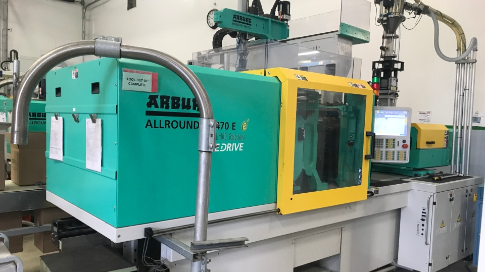 Machine used to make plastic face shields for frontline workers by Molded Precision Components in Oro-Medonte, Ont, on April 24, 2020  (Aileen Doyle/CTV News)