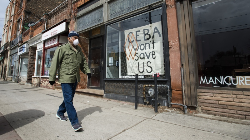 A closed store front boutique business called Francis Watson pleads for help displaying a sign in Toronto on Thursday, April 16, 2020.THE CANADIAN PRESS/Nathan Denette