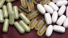 Echinacea, fish oil, and glucosamine pills are shown in San Francisco, Thursday, July 30, 2009. (AP Photo/Eric Risberg)