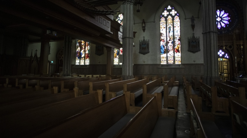 Pews are empty at St. Michael's Cathedral in Toronto, on Wednesday March 25, 2020, after churches were closed due to the COVID-19 pandemic. THE CANADIAN PRESS/Chris Young