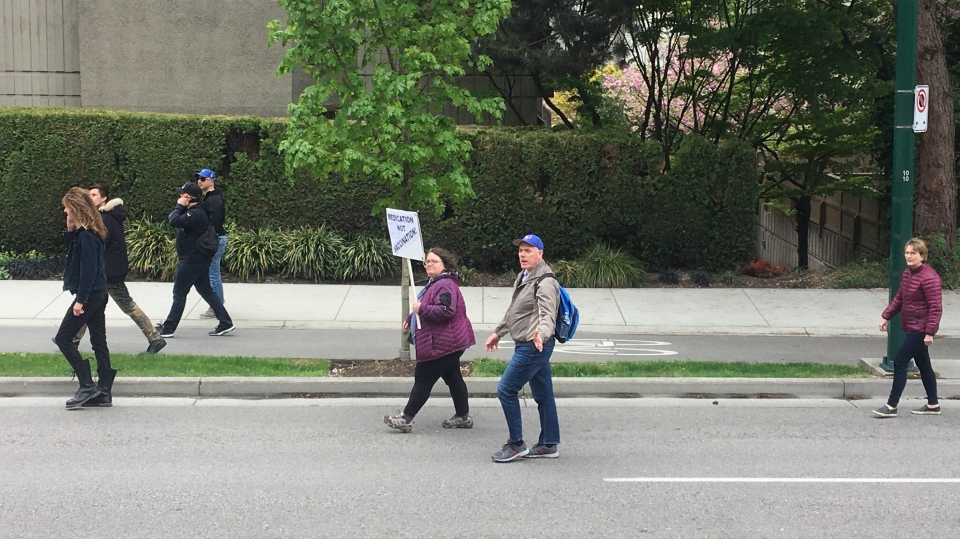 People march in Vancouver's West End on Sunday, April 26, 2020 in defiance of health recommendations to avoid gathering in large groups to prevent the spread of COVID-19. (Submitted)