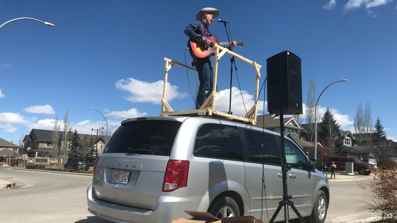 Calgarian Matt Masters has found new business offering 'curbside concerts' which abide by physical distancing rules while performing for small live audiences. (file)