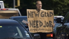 Jordan Smith, a recent graduate of Memorial University in St. John's, takes his job hunt to the streets of Halifax on Tuesday July 14, 2009. (THE CANADIAN PRESS/Andrew Vaughan)