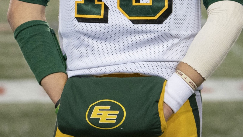 The CFL's Edmonton Eskimos has decided to keep their team name as it is. Eskimos quarterback Logan Kilgore (15) looks on from the sidelines late in the second half CFL football game action against the Hamilton Tiger Cats, in Hamilton, Ont., Friday, Oct. 4, 2019. THE CANADIAN PRESS/Peter Power