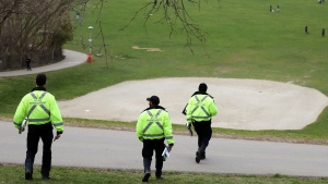 Toronto bylaw officers descend on a park on Friday, April 24, 2020 to enforce anti-COVID-19 rules. Most people left when they arrived but one man received a $750 fine for having his dog off-leash. THE CANADIAN PRESS/Colin Perkel