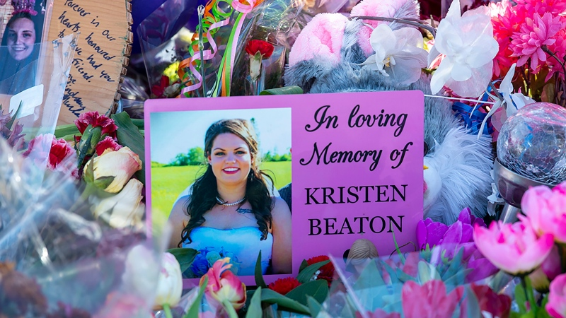 A photo of Kristen Beaton is displayed at a memorial in Debert, N.S. on Sunday, April 26, 2020. The VON care worker was shot and killed when she stopped along the road. (THE CANADIAN PRESS/Andrew Vaughan)