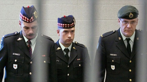 Cpl. Matthew Wilcox, the 24-year-old soldier from Glace Bay, N.S., who was convicted in July of criminal negligence causing death and neglect of duty, is framed by a railing as he is escorted from his sentencing hearing in Sydney, N.S. on Friday, Sept. 11, 2009. (THE CANADIAN PRESS/Andrew Vaughan)