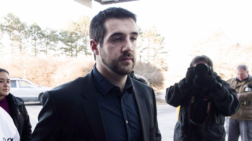 Marco Muzzo, right, arrives with family at the court house for his sentencing hearing in Newmarket, Ont., on February 23, 2016. THE CANADIAN PRESS/Nathan Denette