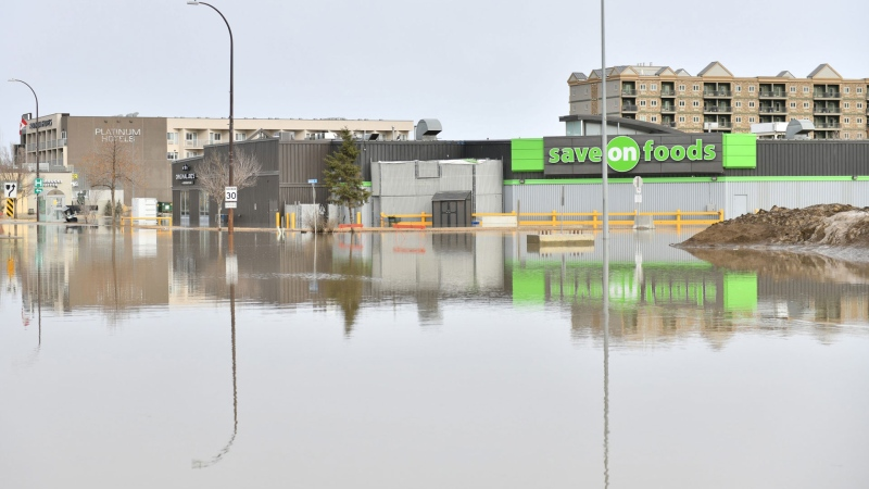 A grocery store is surrounded by flood water on Franklin Avenue in Fort McMurray, Alta. on Monday, April 27, 2020. THE CANADIAN PRESS/Greg Halinda