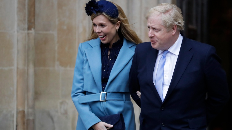 """In this Monday, March 9, 2020 file photo Britain's Prime Minister Boris Johnson and his partner Carrie Symonds arrive to attend the annual Commonwealth Day service at Westminster Abbey in London. Boris Johnson and his partner Carrie Symonds have announced she gave birth to a """"healthy baby boy at a London hospital earlier this morning"""" Wednesday April 29, 2020, and that both mother and baby are doing well. (AP Photo/Kirsty Wigglesworth, File)"""