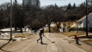 Jamie Roy and his son play street hockey together, during the COVID-19 pandemic, in Edmonton on Thursday, April 16, 2020. THE CANADIAN PRESS/Jason Franson