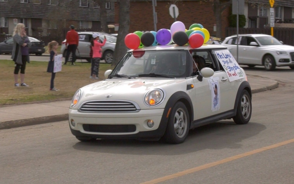 Principal Lema driving by students in a St. Jerome's staff parade. April 29, 2020. (Dave Mitchell/CTV News Edmonton)