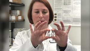 Marianne Stanford, vice-president of research and development at IMV, holds vials filled with components of what could be a vaccine for COVID-19 during CTV News' exclusive look inside the Dartmouth lab.