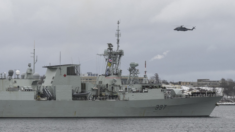 A Cyclone helicopter flies over HMCS Fredericton as its crew leaves the Halifax Harbour for a six-month deployment to the Mediterranean Sea as part of NATO's Operation Reassurance in Halifax on Monday, January 20, 2020. THE CANADIAN PRESS/Darren Calabrese