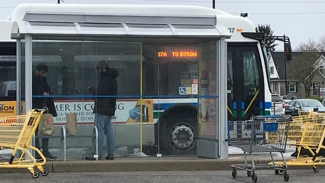 Riders wait to board an LTC bus at London, Ont.'s Argyle Mall on Wednesday, April 28, 2020. (Sean Irvine / CTV London)