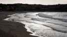 Surfers enjoy the water at Bondi Beach in Sydney, Tuesday, April 28, 2020. (AP Photo/Rick Rycroft)