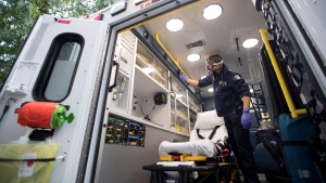 B.C. Ambulance paramedic Jeff Booton cleans his ambulance at station 233 in Lions Bay, B.C. on Wednesday, April 22, 2020. THE CANADIAN PRESS/Jonathan Hayward