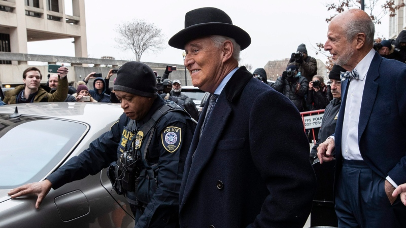 Roger Stone, center, departs federal court in Washington, Thursday, Feb. 20, 2020. (AP Photo/Alex Brandon)