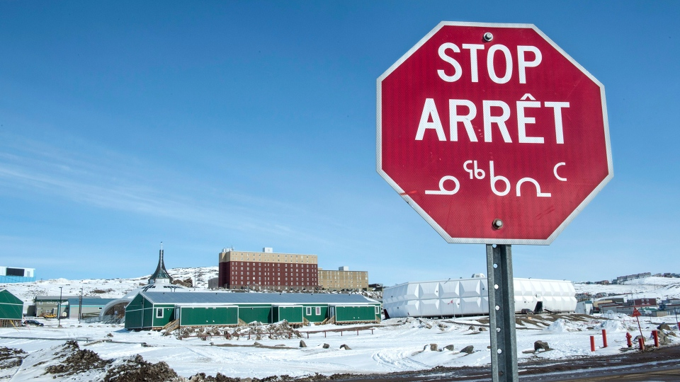 A stop sign in English, French and Inuit is seen in Iqaluit, Nunavut on April 25, 2015. The Inuit Circumpolar Council says if the novel coronavirus spreads to the north its communities in Canada, Alaska and Greenland are at a much higher risk of exposure because of a chronic lack of basic infrastructure and resources. The group says the Inuit must be considered in the government's national and regions response and preparedness plans for coronavirus and the potential compounding threat to basic health and well-being in those communities. THE CANADIAN PRESS/Paul Chiasson