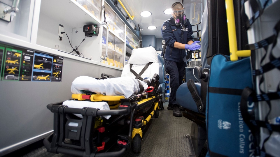 B.C. Ambulance paramedic Jeff Booton cleans his ambulance at station 233 in Lions Bay, B.C. Wednesday, April 22, 2020. Booton was among the people who cared for a COVID-19 patient. The doctors and nurses who care for the critically ill already understand death is a reality. But COVID-19 has added an emotional burden to their work. THE CANADIAN PRESS/Jonathan Hayward
