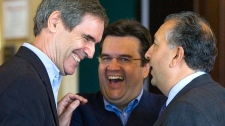 From left, Liberal leader Michael Ignatieff, MP Denis Coderre and MP Paul Zed share a laugh at the national liberal caucus in St. John's, N.L. on Wednesday, August 29, 2007. (Jonathan Hayward / THE CANADIAN PRESS)
