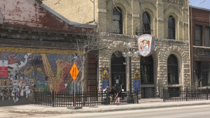 Outside the King's Head Pub, workers installed fencing to prepare the business for phase one of the province's strategy.(Source: Josh Crabb/ CTV News Winnipeg)