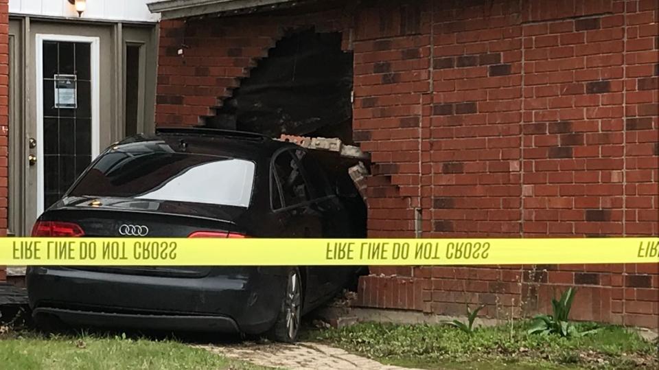 A car crashed into a house