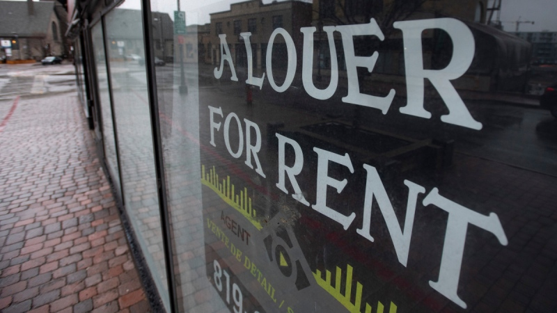 A for rent sign hangs in the window of a commercial space in Gatineau, Que., on April 30, 2020. (Adrian Wyld / THE CANADIAN PRESS)