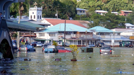 A main road in the downtown area of Fagatogo, American Samoa is flooded by water on Tuesday, Sept. 29, 2009. (AP / Fili Sagapolutele)