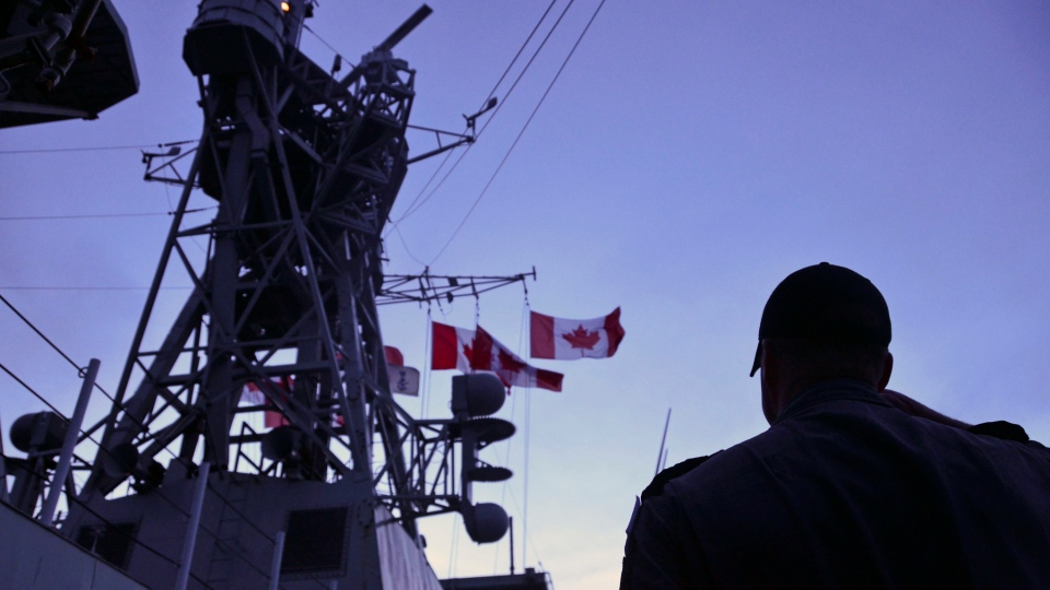 Crew members aboard HMCS Fredericton pay their respects to the fallen during the vigil for the deceased members of the CH-148 Cyclone accident, in the Mediterranean Sea on May 1, 2020. (CREDIT: CPL. SIMON ARCAND, CANADIAN ARMED FORCES PHOTO)