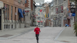 A runner makes his way through the empty streets of Old Montreal, Wednesday, April 1, 2020.THE CANADIAN PRESS/Ryan Remiorz