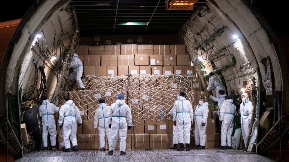 A crew get ready to unload medical supplies from an Antonov AN-225 cargo transporter upon arriving from China at Mirabel Airport in Mirabel, Que. on Friday, May 1, 2020. THE CANADIAN PRESS/Paul Chiasson