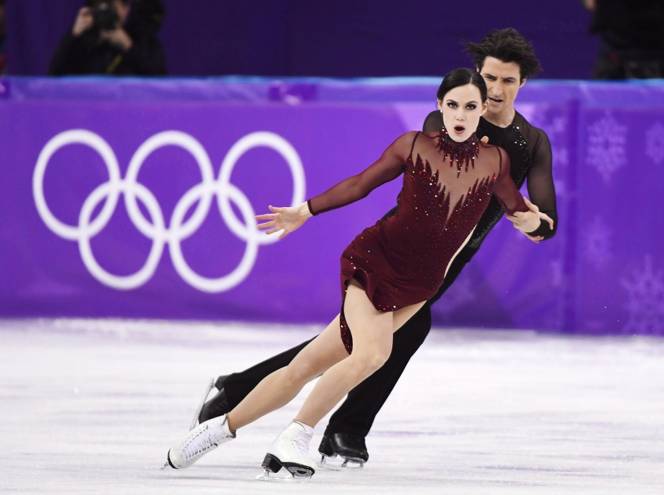 Tessa Virtue and Scott Moir compete in the ice dance figure skating free dance at the Pyeongchang Winter Olympics, Tuesday, February 20, 2018 in Gangneung, South Korea. Mathieu Caron, who designed costumes for Tessa Virtue, is selling luxury face masks made from the same material as the costumes Virtue wore. All profits will go to the World Health Organization. THE CANADIAN PRESS/Paul Chiasson