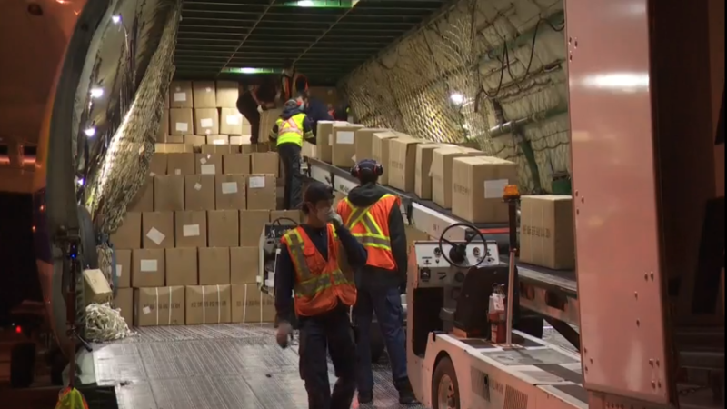 Workers on a massive cargo plane carrying personal protective equipment (PPE) for the COVID-19 pandemic. (CTV)