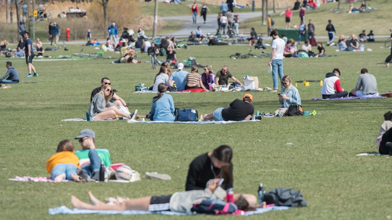 People enjoy a warm day in a park in Montreal, Saturday, May 2, 2020, as the COVID-19 pandemic continues in Canada and around the world. (THE CANADIAN PRESS / Graham Hughes)