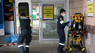 Paramedics disinfect medical equipment after transporting a patient to the emergency department at a hospital during the COVID-19 pandemic in Toronto on Thursday, April 30, 2020. (Nathan Denette/The Canadian Press)