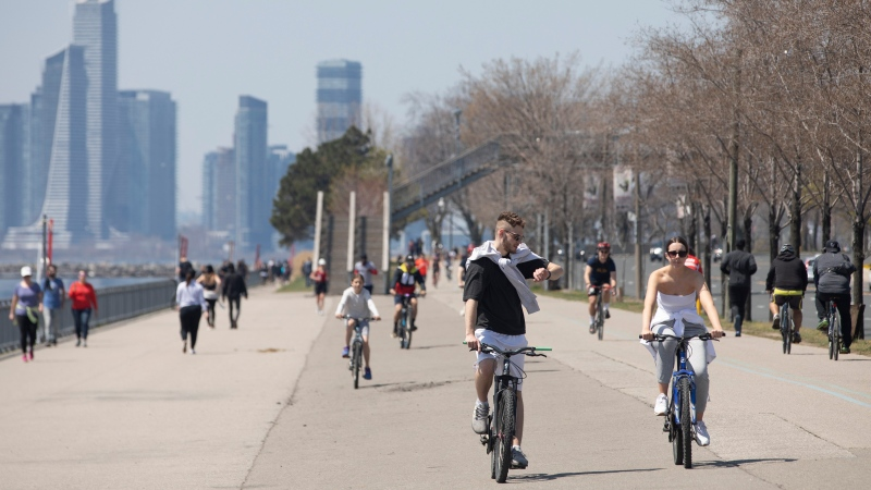 People exercise in the warm weather in Toronto, on Sunday, May 3, 2020. THE CANADIAN PRESS/Chris Young